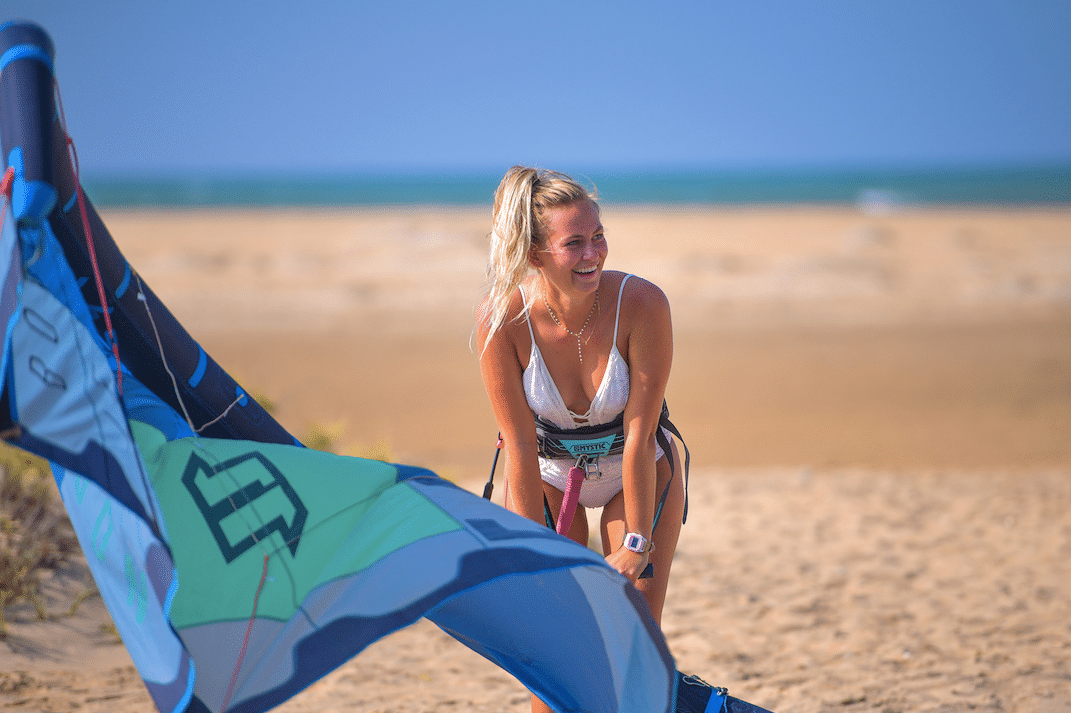 Girl pumping up a kite